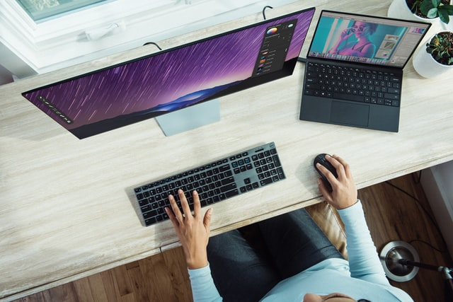 Person working on their desktop computer