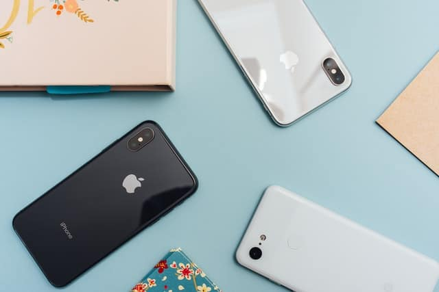A few smartphones face down on